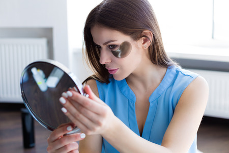 Woman choosing a skincare products. Hight angle view Archivio Fotografico