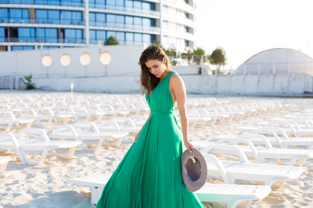 Beautiful young woman in a green gown on the beach 写真素材 - 107492337