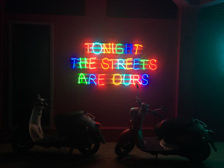 Glowing neon city lights that read