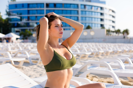 Beautiful woman wearing bikini and tanning on the beach 写真素材 - 105868477
