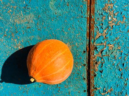 Ripe orange pumpkins on a wooden background