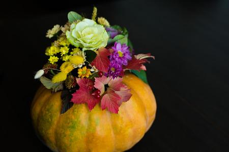 Festive Thanksgiving autumn flowers arrangement in a pumpkin 写真素材 - 106214021