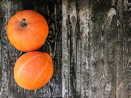 Ripe orange pumpkins on a wooden background 写真素材 - 106213683