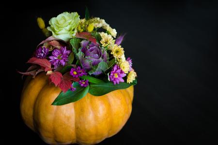 Festive Thanksgiving autumn flowers arrangement in a pumpkin