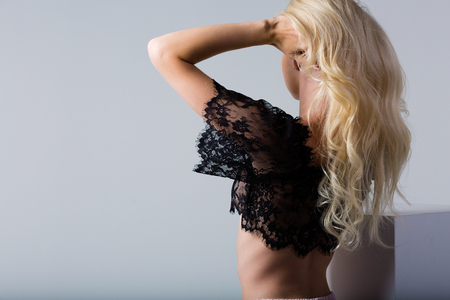 Beautiful blonde woman wearing a set of lace lingerie 写真素材 - 106727203