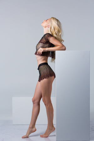 Beautiful blonde woman wearing a set of lace lingerie