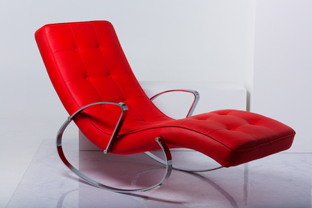 Modern red rocking armchair in the studio 写真素材 - 107492475