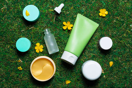 Cosmetics on a spring background high angle view