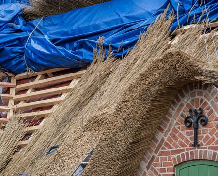 a new thatched house is built