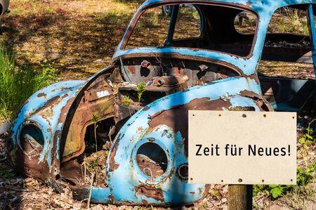 Old car Time for new sign Reklamní fotografie