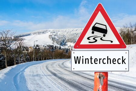 Attention wintercheck sign Archivio Fotografico