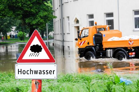 Flood warning warning sign flooding Stock Photo