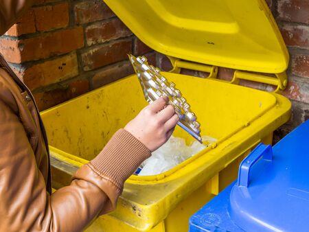 Yellow ton of plastic garbage