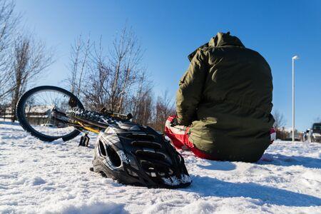 Falling by bike in winter Stock Photo