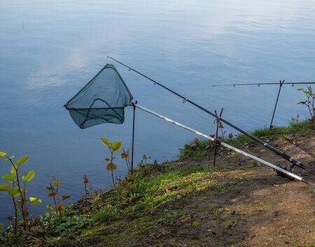 Landing net and fishing rod Foto de archivo - 130207097