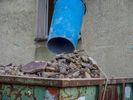 Building rubble chute with container Stock Photo