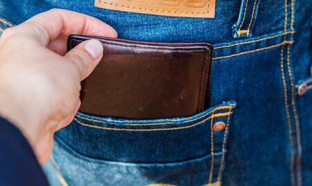 Stealing a purse from a trouser pocket