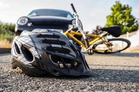 Accident by bike with helmet Stock Photo