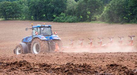 agriculture, tugboats ploughing over Reklamní fotografie