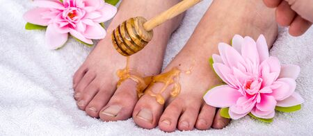 Panorama of a foot honey massage