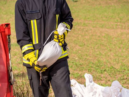firefighter with sandbag Stock Photo