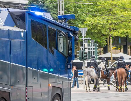 Water cannons and policemen on horses in action