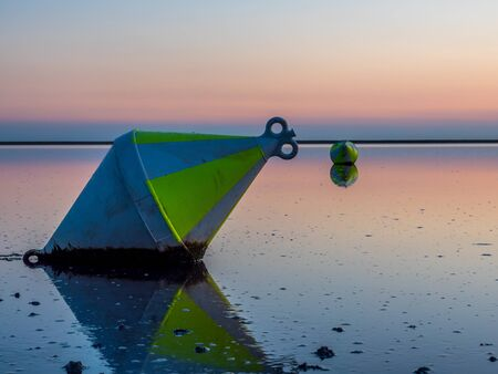 Buoy in the Wadden Sea at the North Sea