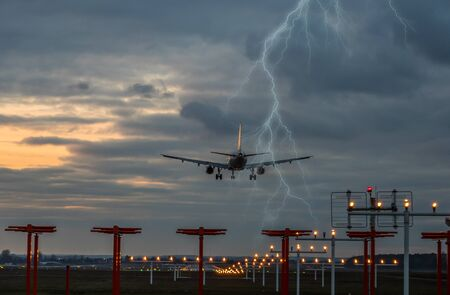 Thunderstorm on landing airplane at the airport