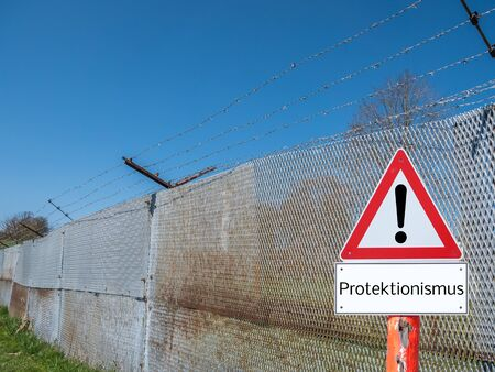 Border fence with warning sign protectionism in German
