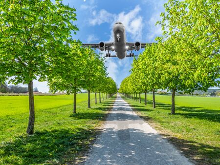 Aircraft noise over the park residential area Stock Photo