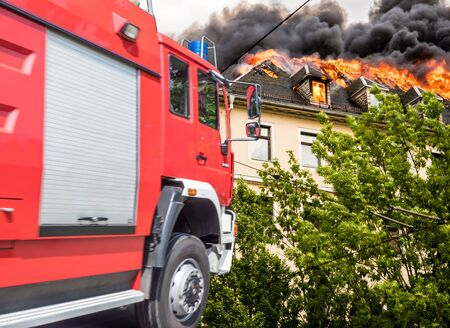 Fire department at a roof fire Stock fotó