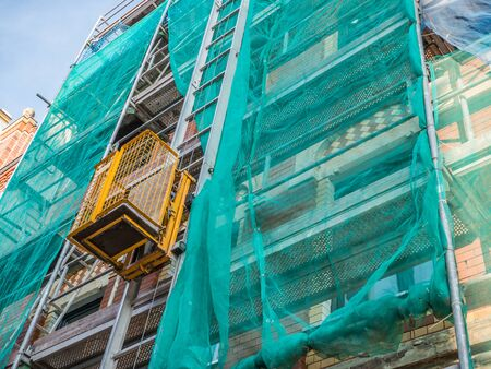 scaffolding with freight elevator 免版税图像