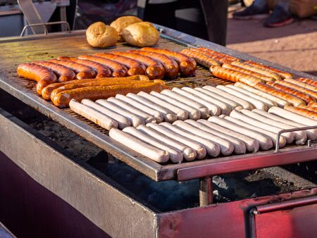 Roasted sausages on a grill Standard-Bild