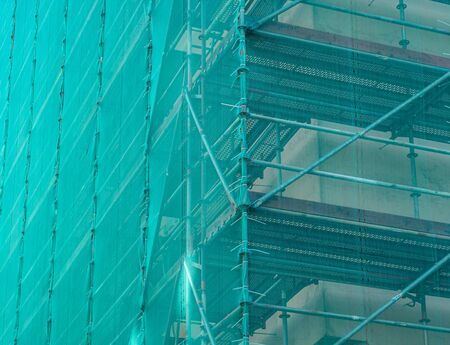 Building renovation scaffolding with net 版權商用圖片