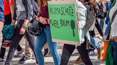 Climate protection demonstration with poster in german Imagens