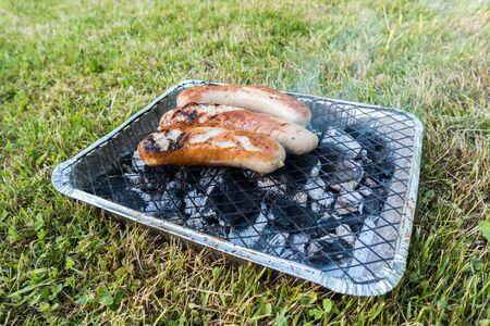 Disposable barbecue with bratwurst