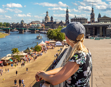 Young touristess looks on Dresden in Saxony Editorial