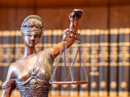 Justitia figure justice statue in lawyers office Stock fotó