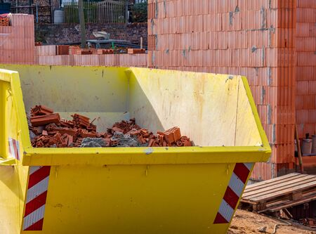 Construction container with rubble from the shell Stock Photo