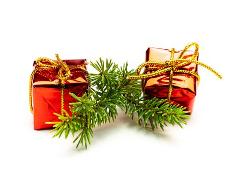 Fir branch isolated with red gifts