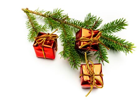 Fir branch with red gifts isolated on white background