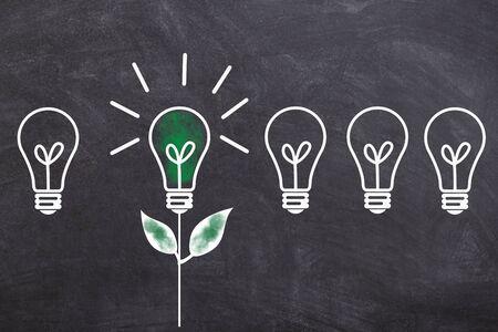 Light bulb green energy green electricity on a blackboard