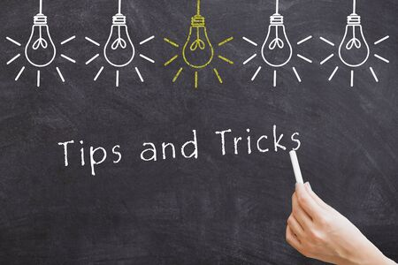 Tips and tricks word blackboard with light bulbs