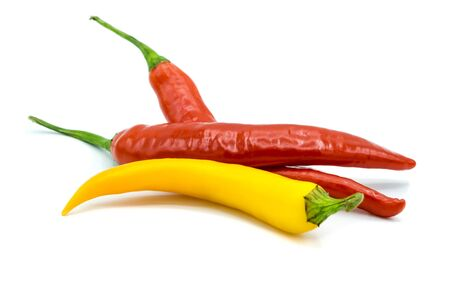 yellow and red hot peppers isolated on white background