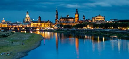 Panoramic skyline of Dresden with Elbe at night