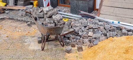 Panoramic wheelbarrow with paving stones road construction