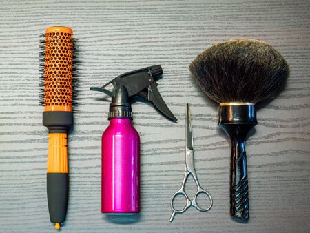 Barber tools on a wood background