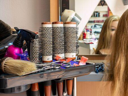 Hair salon Blonde woman cutting hair