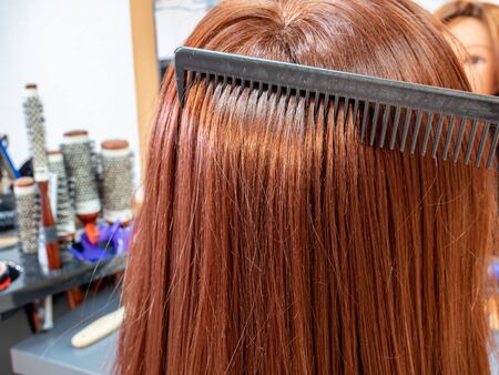 Woman with red hair at the hairdresser Stock fotó