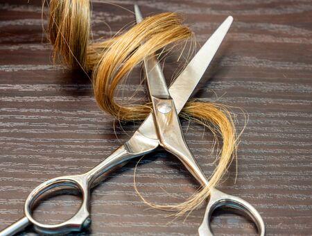 Barber scissors and curl background Stock fotó